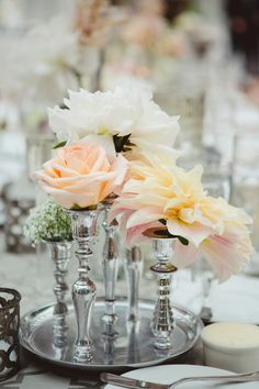 Roses and dahlias in silver vases  #roses, #centerpiece, #dahlia  Photography: Closer to Love Photography - closertolovephotography.com  Read More: http://stylemepretty.com/2013/08/19/san-juan-capistrano-wedding-from-closer-to-love-photography/