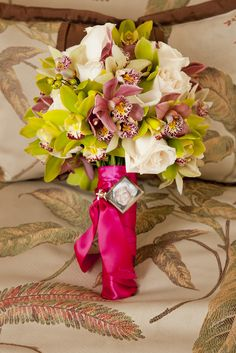 DIY Wedding Flowers-   I followed this website:  http://www.diynetwork.com/videos/stunning-orchid-bridal-bouquet-video/6549.html    I also used roses and purple cymbidium orchids. I saved a ton of money doing my own flowers!! =)
