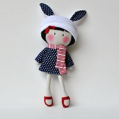 """Open to all. Limit of ONE 11"""" My Teeny-Tiny Doll® per buyerMy Teeny-Tiny Dolls® are 11"""" Handmade Fashion Dolls. Made from cotton and wool felt fabrics, filled with polyfil for softness.My Teeny-Tiny Doll® Willow's reversible long sleeve A-Line dress, scarf and bunny hat are removable and her red Mary Jane shoes are handpainted with non-toxic acrylic paint.Due to the handmade nature of the doll and small parts, recommended for children 3 and up. Children shou..."""