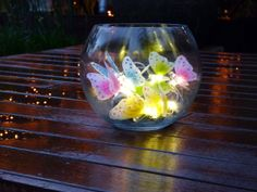 Solar-power butterflies in a bowl Solar Fairy Lights, Solar Power, Wine Glass, Butterflies, Lighting, Tableware, Diy, Dinnerware, Solar Energy