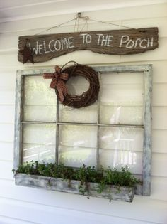 Love the wreath and sign on and above the window.