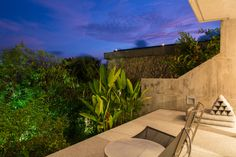 A gorgeous patio at Villa Benyasiri, one of our five-bedroom, luxury, holiday villas in Phuket.