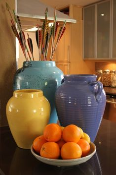 Oil Jars - love this for storing grocery bags