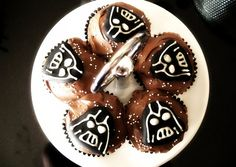 cute darth vadar cupcakes. thinking about doing these for sarah's birthday.  http://kidsactivitiesblog.com/star-wars-cake-ideas/