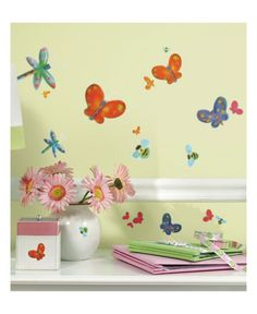 Room Mates Jelly Bug Wall Stickers are a great way to create a feature with minimal fuss and effort. The fun design has an insect theme featuring colourful butterflies, ladybirds and bees! Each element of the design simply peels off the backing sheet and can be stuck to any smooth surface. The stickers are also repositionable so if you aren't happy with them the first time, you can move them around until you have the perfect themed feature!
