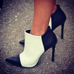I don't wear heels but these boots are cute! I love a good white/black combo.