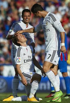 Cristiano Ronaldo (R) of Real Madrid reacts to his teammate Luka Modric during the La Liga match between Levante UD and Real Madrid at Ciutat de Valencia on October 18, 2014 in Valencia, Spain.