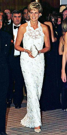 People: THE CHIC YEARS: 1992-1997 Diana charmed America on her first official visit since her divorce, attending a charity event in Washington, D.C., in an elegant cream lace gown. Credit: Tim Graham/Corbis