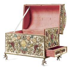 A Dutch embroidered, raised work and applique metal thread floral coffer,  half 17th century