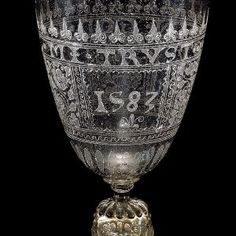English 1580 Wine Glass Detail of Engraving by Anthony de Lysle, a French Huguenot refugee  living in London  He was an Engraver and a Pewter Artisan