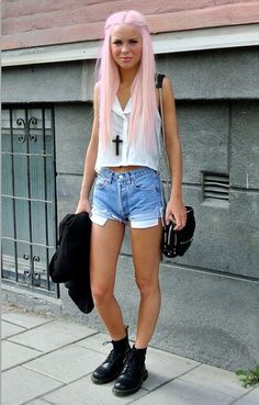 light pink hair, sheer shirt, high waisted shorts and long necklace, short combat boots