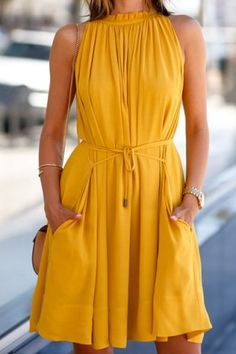 Be bold with this mustard yellow dress.  Has a gorgeous scoop neck neckline with a drawstring waist!