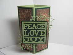 2015 Corner Card made by Sharon Frees. The holly die is from MB, the Peace Love Joy die I forgot where it came from.
