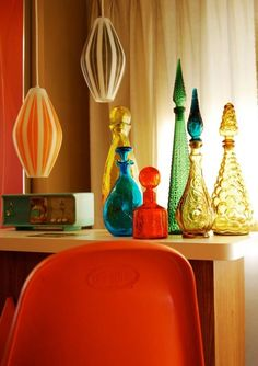 70s decor think mom had ALL these bottles on a shelf in front of HUGE picture window in kitchen............not sure about that red one tho'..................i think she had that shape in green and a tall one in red.......still remember how the light would hit them all
