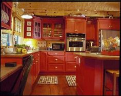 kitchen wall in paprika and cupboards red | the wall heater unit behind the island ferrari kitchen with pen kiche ...