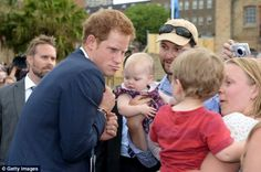 Joking about: Prince Harry is greeted by members of the public during the 2013 International Fleet Review in Australia