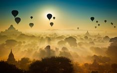 Hundreds of temples provide a perfect backdrop as more than 20 hot air balloons are silhouetted against the sunrise. The early morning light creates an ethereal look to these photographs which were taken from the top of one of the many temples in Bagan, Burma. Photographer Alberto Maccagno, 43, of Barge, Piedmont, Italy,