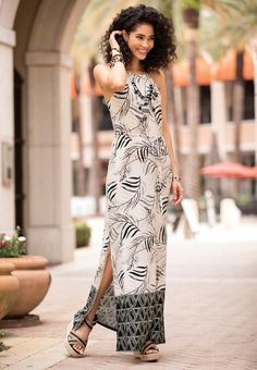 Tropical Oasis - Get away and get glam in our bordered palm frond maxi dress, featuring a sultry side slit. Striped straw wedge sandals and chunky beaded jewelry deliver a adventurous finish to this look.