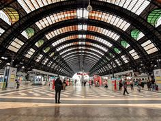 Italy's second-largest station (after Rome's Stazione Termini) opened in 1931. It was originally modeled after Union Station in Washington, D.C., but when Mussolini came into power, he expanded the Beaux Arts design to include elements of Art Nouveau and Art Deco. The stunning results feature 118,000 square feet of marble flooring, an array of muscular stone sculptures, and five train sheds covered with vast iron-and-glass canopies.