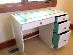 Refinished white and teal desk.