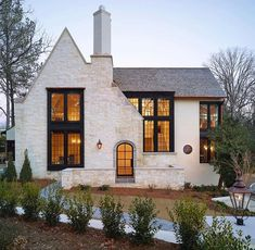 Modern Farmhouse house exterior ideas with white brick. Love the lines of the front roof and how it intersects with the main roof line. Curb appeal ideas, house exterior inspo, white houses with gray roofs Future House, My House, Cottage House, Tudor Cottage, Cottage Style, English Cottage Exterior, Tudor House Exterior, English Tudor Homes, Grand House