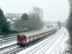London Underground trains powered through the snow this evening in North West London as other stations in the capital announced they were closing London Underground Train, Flood Warning, Uk Weather, West London, Uk News, North West, Roads, Trains, Old Things