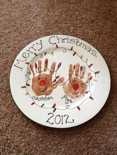 Christmas reindeer handprint plate (love the eyelashes on the girl reindeer). Add a bow too.