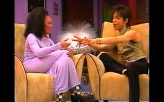 Prince poking fun at Scary Spice about her hand gestures as she tried to describe how his music makes her feel.