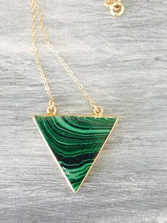 A personal favorite from my Etsy shop https://www.etsy.com/listing/198231213/gold-filled-chain-necklace-and-malachite