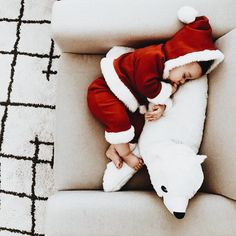 December 22nd, we are getting ready for St. Nick and what better way to celebrate than with this Muse of the day...a little St. Nick himself all snuggled up and snoozing for the day when Santa comes. Evie & Adrienne || Sustainable Baby Clothing and Accessories || Made in America || Be The Good || Fertility Awareness || www.evieandadrienne.com