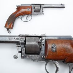 Dreyse Revolver - While his father's zundnadelgewehr (needle-gun) was only a single-shot – Franz von Dreyse went for repeating capability with his revolver design.  Made in .32, .35 and our example's .39 caliber in the late 1860s; perhaps this wasn't the best time to offer a handgun that required a long needle firing pin to detonate the primer deep inside the cartridge? The Dreyse revolver saw limited military and commercial acceptance. At the NRA National Firearms Museum in Fairfax, VA