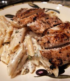 Creamy Grilled Chicken Piccata:    Chicken   Juice of 1 lemon (3Tbsp)   3 Tbsp olive oil   1 Tbsp minced garlic   1 tsp salt   1/4 tsp black pepper   1/2 tsp basil or oregano   2 boneless, skinless chicken breasts     Pasta   2 cups dried penne pasta   2 Tbsp butter   Juice of 2 lemons (6 Tbsp)   1 Tbsp minced garlic   1/2 cup half and half (or heavy cream)   2 tsp dried basil   2 Tbps capers   1/2 cup grated parmesan cheese     Chicken   Combine first 6 ingredients and mix well.  Place chick...