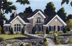 A European Country flare is showcased on the exterior facade of this exciting two-story home.  The grand two story foyer entrance with staircase is open to the spacious two story great room with fireplace and high windows across the rear wall.   European House Plan # 161041.