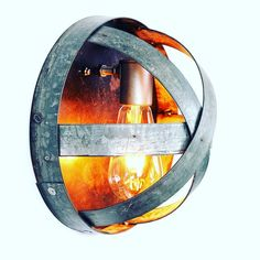 ATOM wall light made entirely from retired Napa wine barrel rings and recycled steel.