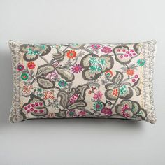 Enliven your favorite sitting spots with vivid pops of color. Our beautifully embroidered lumbar pillow crafted from recycled plastic bottles portrays bright blooms in a spectrum of hues.