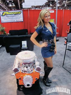 Model, Actress, and PROFORM Girl, Amber Hay, protecting the expensive Bling Engine at SEMA!