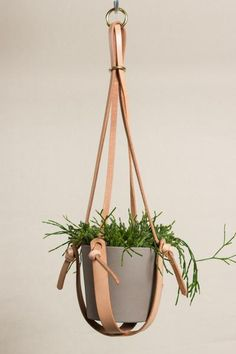"Made strong with thick vegetable-tanned leather straps, this hanging plant holder can hold almost any size pot. Strap drop: 21"" About Open Habit: Owned and run by Heather Lin out of Portland, Oregon, Open Habit formed out of a long history with and love of sewing, bags and high-quality handmade goods. Carefully designe"
