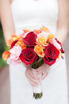 normally I'm not very goo goo over bouquets, but I love this one. That said, ever since one of my brides said her sister looked like a clotting white blood cell surrounded by dried blood, I've had trouble with the red palette. -_-