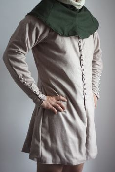 Jopula       It's made of four parts, with long sleeves, extended three wedges.  Fastened with buttons on the front and on the sleeves (for the price of 36 buttons textile)  Standard sewn from wool with linen lining.