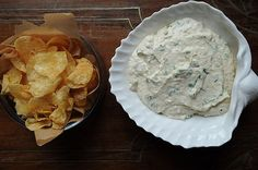 Caramelized Onion Dip  5 pounds Spanish onions   8 ounces cream cheese   16 ounces sour cream   zest and juice of 1 lemon   1 bunch chives   4 tablespoons olive oil  salt & pepper