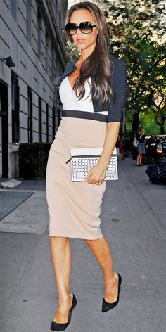 WHAT SHE WORE During Fashion Week, Victoria Beckham strolled in N.Y.C. in a beige and white dress dress, cropped cardigan and oversize shades.
