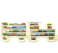 Wooden Wall Storage Train Rack Organizer for Thomas Tank Engine and Brio Tracks. $59.95, via Etsy.  Love it- it'll be a great way to store those trains now and decorate his room once he's not playing with them anymore.