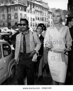 Sammy Davis Jr. walking the streets of Rome with his wife May Britt Stock Photo