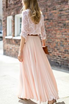 For a soft romantic look, opt for a pleated maxi in a cream or blush tone and pair it with a lightweight blouse in the same color family. Just add sandals and neutral accessories for a perfect breezy summer look.