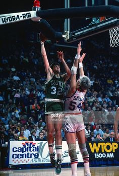 Kevin McHale #32 of the Boston Celtics shoots over Tom McMillen #54 of the Washington Bullets during an NBA basketball game circa 1984 at the Capital Center in Landover, Maryland. McHale played for the Celtics from 1980-94.