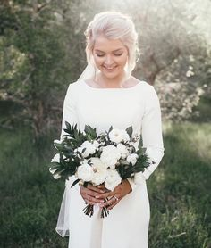 Boatneck wedding dress with long sleeves & white flowers!