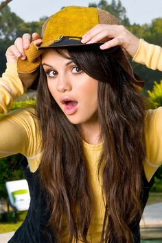 Selena Gomez is a cool hippy Hoppy (hip hop) girl. Looks good in yellow. This weeks topic. Selena Gomez June 24-30th