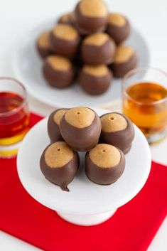 Step aside rum balls, these delicious Peanut Butter Whiskey Balls are what I'm serving for a boozy Christmas treat this year! They taste like a peanut butter ball with an addition of graham cracker crumbs and the warm, fuzzy feeling that your throat and tummy get when you've had a shot of whiskey. I've been... Read On → The post Peanut Butter Whiskey Balls appeared first on Cookie Dough and Oven Mitt. Chocolate Melting Wafers, Chocolate Almond Bark, Chocolate Peanut Butter Cookies, Peanut Butter Desserts, Peanut Butter Balls, Chocolate Filling, Chocolate Desserts, Summer Dessert Recipes, Healthy Dessert Recipes