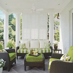 Style Guide: 60 Breezy Porches and Patios | Louvered shutters add a little privacy to this porch space and fresh apple green accents punch up the color scheme. | SouthernLiving.com