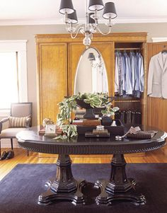 For his dressing room, Jimenez rejected built-ins in favor of a large antique armoire. The double pedestal table is a Palm Springs thrift shop find that he painted black.   - HouseBeautiful.com